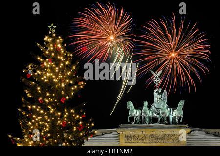 Quadriga on Brandenburg Gate, with christmas tree and fireworks, Germany, Berlin - Stock Photo