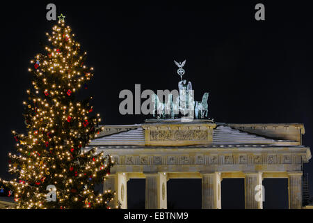 Quadriga on Brandenburg Gate, with christmas tree, Germany, Berlin - Stock Photo