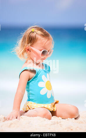 little blonde girl at tropical beach - Stock Photo