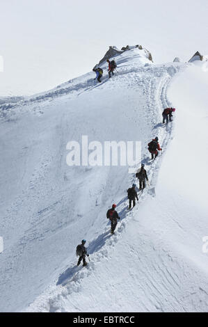 alpinists in snow ascending the Mont Blanc, Italy, Mont Blanc - Stock Photo