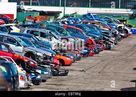 Old cars are piled on a scrapyard, Germany - Stock Photo