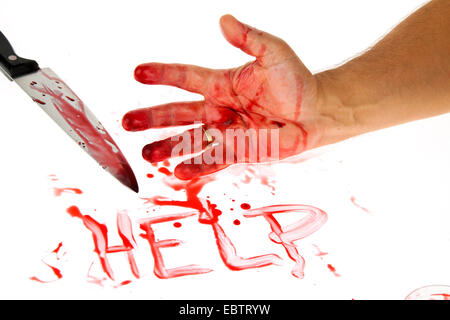 knife smeared with blood, blood-smeared hand and 'help' written with blood - Stock Photo