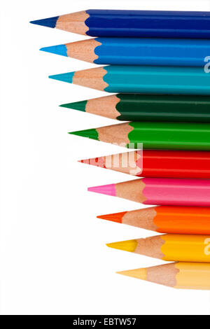 different colored pencils side by side on white background - Stock Photo