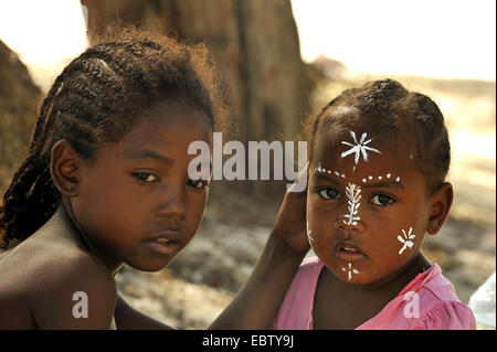 little girl with painted face, Madagascar, Nosy Be - Stock Photo