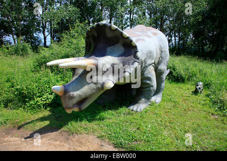 Three Horned Dinosaur (Triceratops), with juvenile on a clearing - Stock Photo