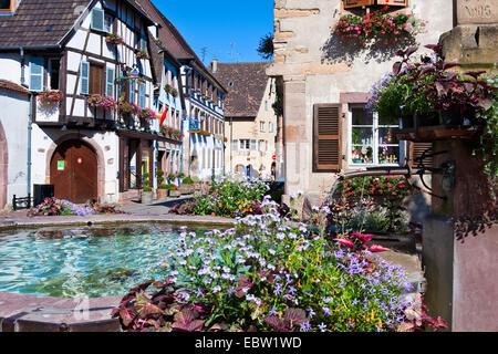 fountain in a picturesque village, France, Haut-Rhin, Alsace, Eguisheim, Egisheim - Stock Photo