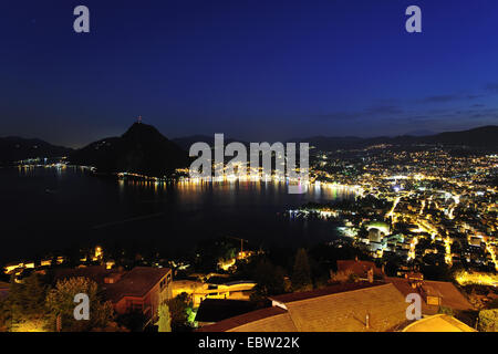 Lugano at Lake Lugano with San Salvatore mountain, Switzerland, Ticino, Lugano - Stock Photo