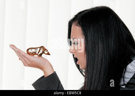 Woman with stock symbol bear. Loss on stock prices - Stock Photo