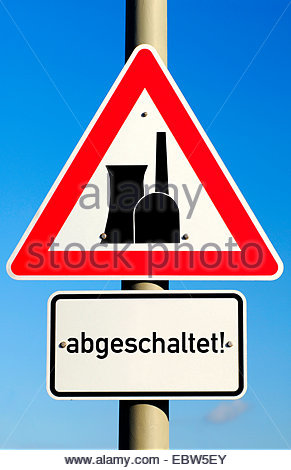 road sign with nuclear power station and word 'abgeschaltet', switched off - Stock Photo
