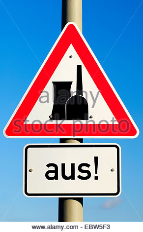 road sign with nuclear power station and word 'aus', switched off - Stock Photo