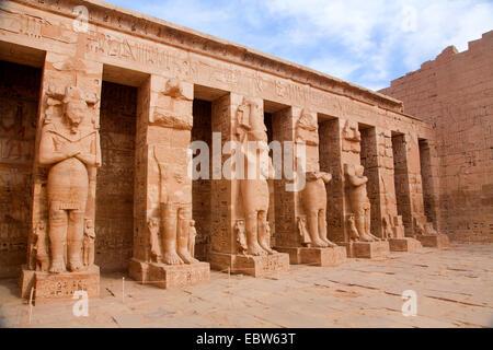 seven columns in the shape of Egyptian god Osiris in Mortuary Temple of Ramesses III, Medinet Habu, Egypt, Theben - Stock Photo