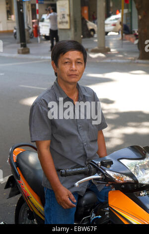 Mototaxi driver in Ho Chi Minh City, Vietnam. - Stock Photo
