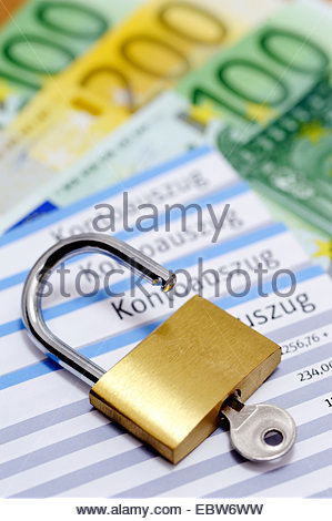 account statement and safety lock, Germany - Stock Photo