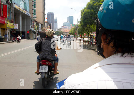 Scooter traffic in Ho Chi Minh City, Vietnam. - Stock Photo