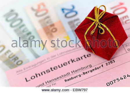 wage tax card, banknotes and present, tax giveaway, Germany - Stock Photo