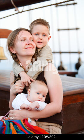 happy mother with her two little children - Stock Photo