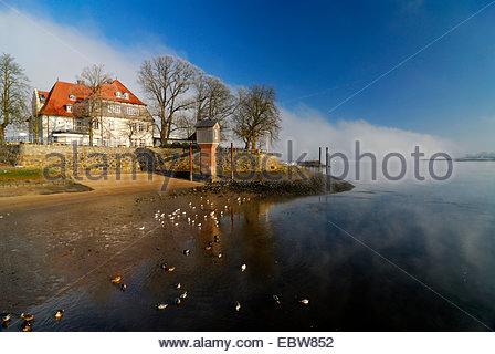 ferry house Zollenspieker in front of a wall of fog over the Elbe, Germany, Kirchwerder, Hamburg - Stock Photo