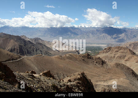 Himalayan mountain road leading out of Leh in Ladakh - Stock Photo