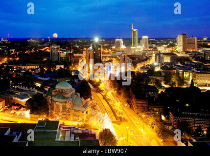 view from city hall to the city with old synagogue and RWE tower in twilight, Germany, North Rhine-Westphalia, Ruhr - Stock Photo