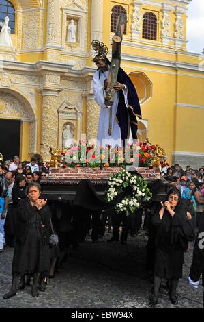 religious procession, women carrying a Jesus statue, Guatemala, Antiqua - Stock Photo