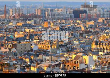 View over the rooftops of Paris in the evening light, Paris, Ile-de-France, France - Stock Photo