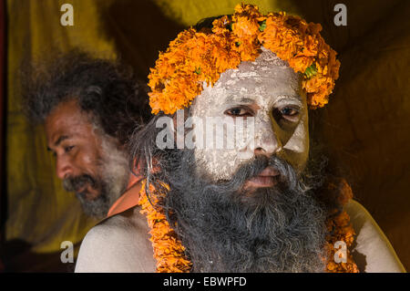 Portrait of a Shiva sadhu, holy man, at the Sangam, the confluence of the rivers Ganges, Yamuna and Saraswati - Stock Photo