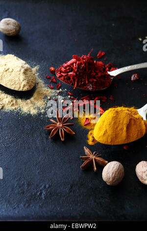 mix of spices on dark background, ingredient - Stock Photo