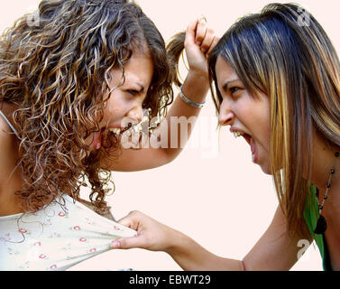 two young women face to face turn violent - Stock Photo