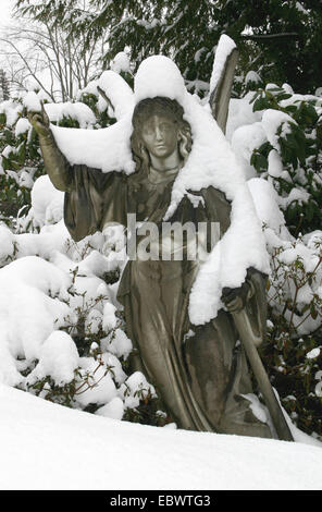 snow-covered statue on a cemetery, Germany, Baden-Wuerttemberg, Baden-Baden - Stock Photo