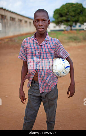 boy with football under his arm, Burundi, Bujumbura - Stock Photo