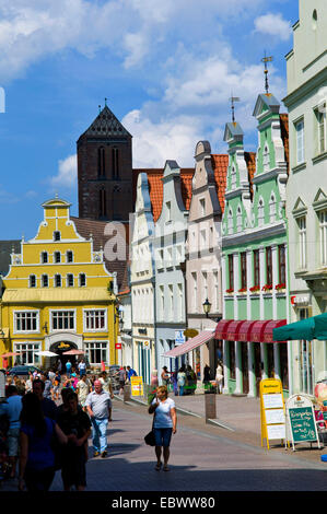 Kroemer Street, Kroemerstrasse, in Wismar, Sankt Nicolai church in the background, Germany, Mecklenburg-Western - Stock Photo