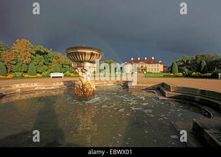 fountain in front of Oranienbaum Palace, approaching thunderstorm, Germany, Saxony-Anhalt, Dessau - Stock Photo