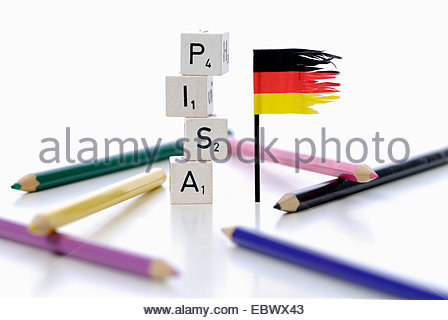 german flag next stack of cubes labeled 'PISA', Programme for International Student Assessment - Stock Photo