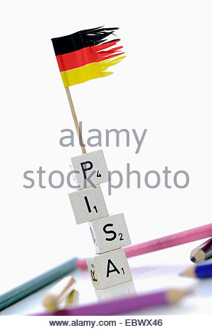 german flag on stack of cubes labeled 'PISA', Programme for International Student Assessment - Stock Photo