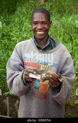 dealer counting money, Burundi, Bujumbura Rural, Bugarama - Stock Photo