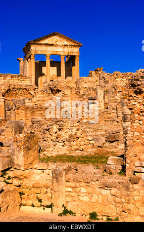 Forum and Capitol Temple in historical 2nd Century Roman ruins in Dougga, Tunisia - Stock Photo