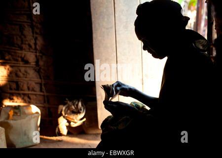 old woman counting money, Burundi, Karuzi, Buhiga - Stock Photo