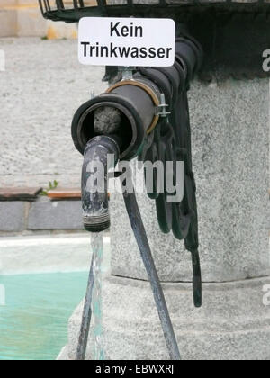 sign at a fountain saying 'Kein Trinkwasser' ('No drinking water') - Stock Photo