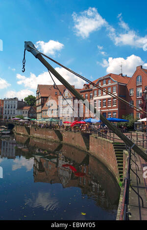 sight of the old hanse-harbor with loading crane at the quay, Germany, Lower Saxony, Stade - Stock Photo