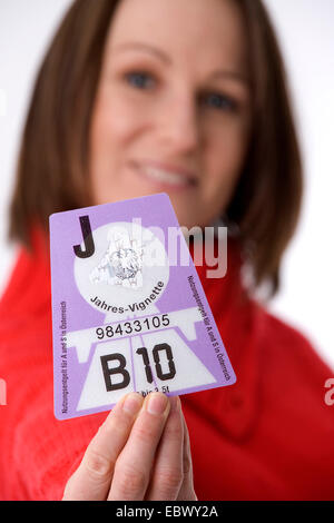 woman with Austrian vignette, Austria - Stock Photo