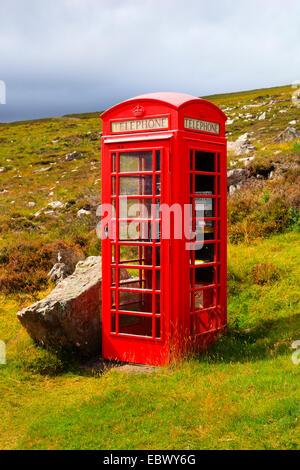 red telephone box in the Scottish Highlands, United Kingdom, Scotland, Sutherland - Stock Photo