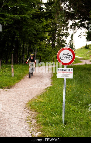 mountainbiker on a way with prohibition sign for bycicle traffic, Austria - Stock Photo