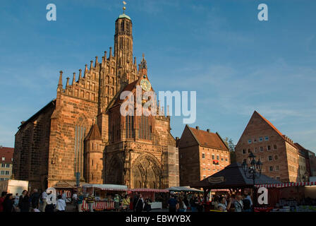 Frauenkirche, Church of Our Lady at main market in evening light, Germany, Bavaria, Franken, Franconia, Nuernberg - Stock Photo