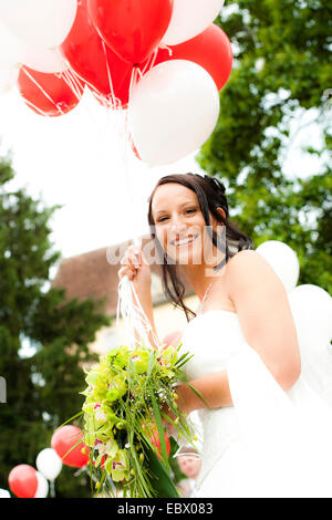 bride with balloons - Stock Photo