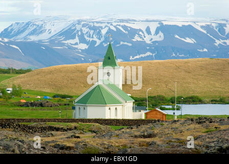 church in Reykjahlid, Eldhraun Lava with field of lava in foreground, Iceland, Reykjahlid - Stock Photo