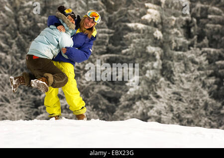 young woman fooling around in winter holydays, France - Stock Photo