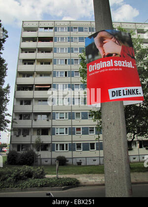 housing estate in former East Germany, socialist buildings, election poster of the left-wing party 'Die Linke' at - Stock Photo