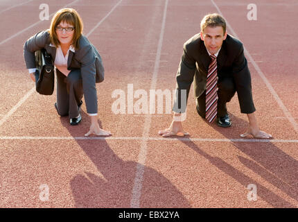 businesspeople at starting line - Stock Photo