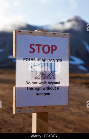polar bear (Ursus maritimus), warning sign polar bear danger, demand for bearing weapons, Norway, Svalbard, Ny Alesund - Stock Photo