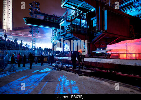 people on a illuminated stand at Zollverein during the opening event of Capital of culture 2010, Germany, North - Stock Photo